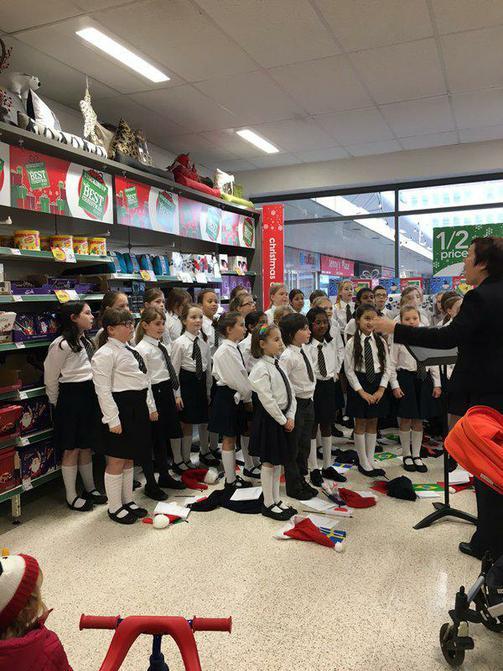 Choir sing in Sale town centre