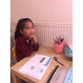 Airada working hard on her maths.