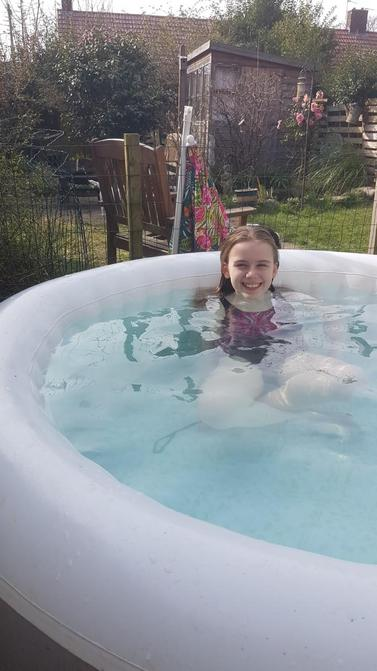 Grace relaxing in the hot tub!