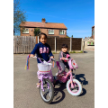 Airada out riding her bike on a sunny day!
