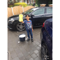 Roshan busy cleaning the family car