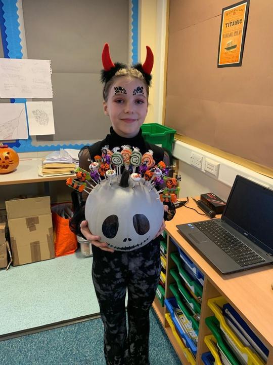 Lola won the best pumpkin award!
