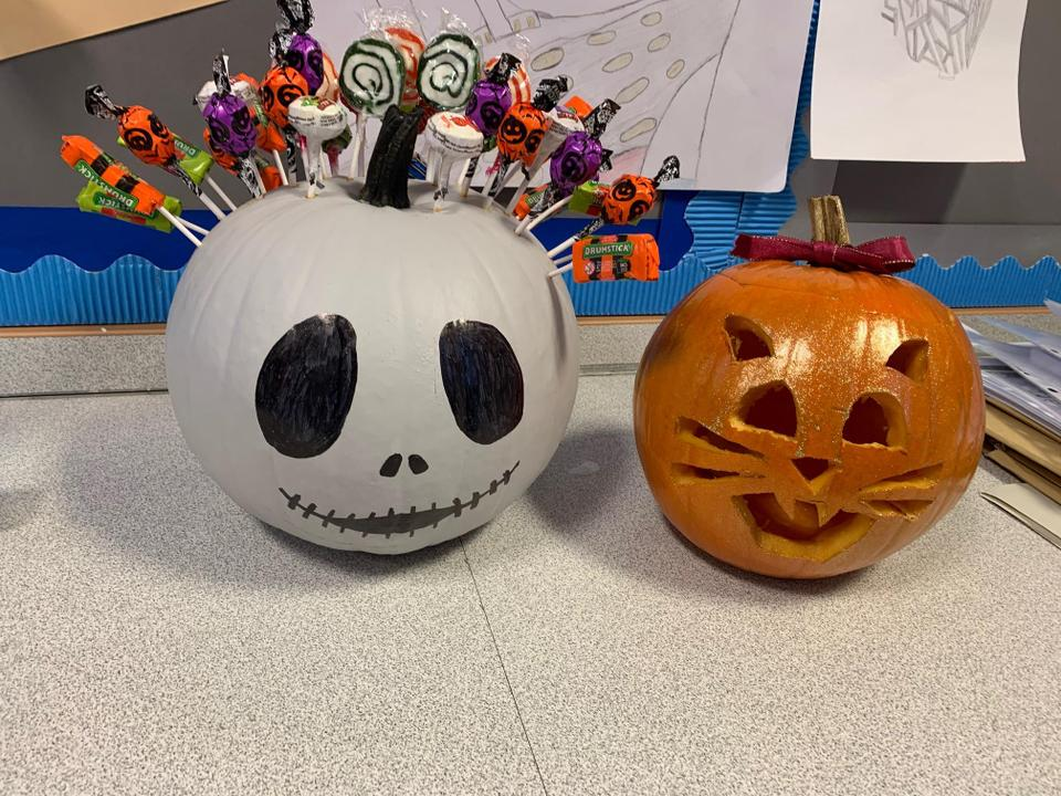 Some children decorated pumpkins at home