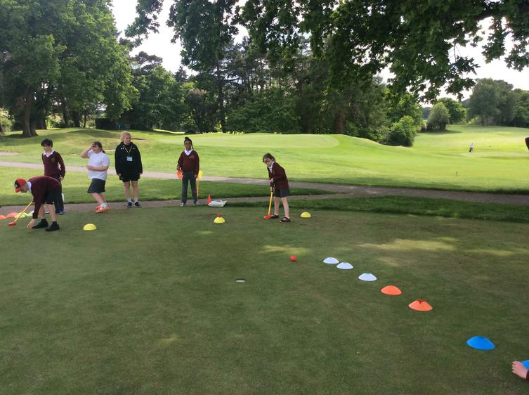 Pupils practising their golf skills