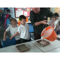 Neil poured plaster of paris into the moulds