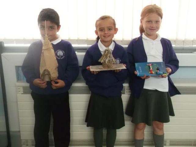 Michael, Darcey and Nikola built Stone Age homes