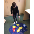 Toby fishing for some toys to practise his initial sounds.