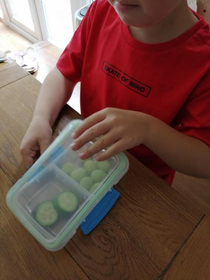 Practise opening snack and lunch boxes