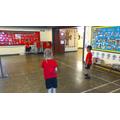 Practicing our underarm serve in Badminton
