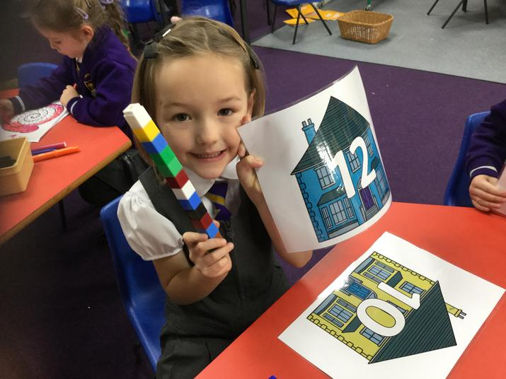 'I have one tower of 12 cubes ~ more cubes than 10.'