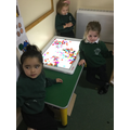 Making pictures with 2D shapes on the lightbox