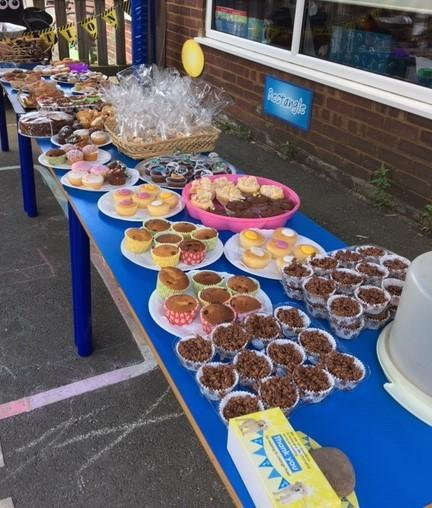 The cakes were displayed ready for the cake sale.