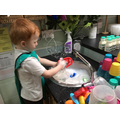 Drew is 'washing up dishes like his Mummy'.