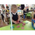 Olivia made hearts in the playdough.