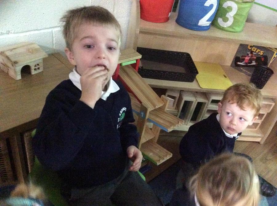 Nicholas enjoyed trying hot cross buns.