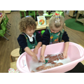 Bella and Ariana enjoyed washing their dolls because 'Mummy baths them'.