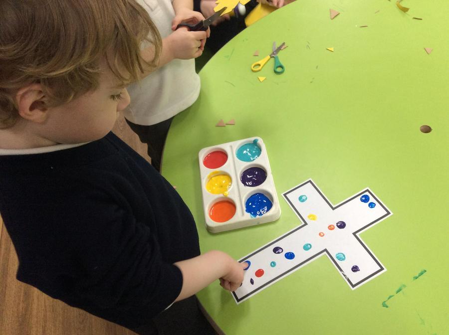 Ethan adding his fingerprints onto the class cross.