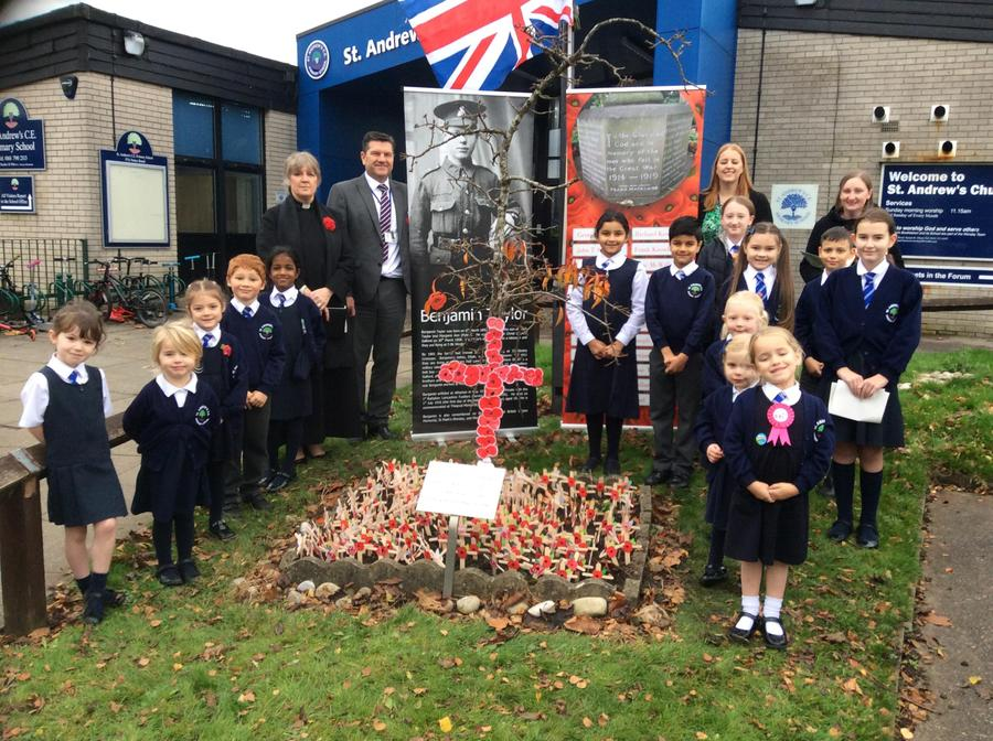 Our children laid poppies at the front of school.