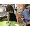 Harriet cut out a heart shape in the salt dough in preparation for her keyring.r