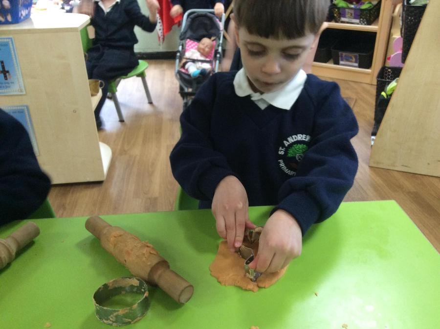 Christos using the Easter cutters in the playdough.