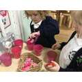 Bella enjoyed counting 'pink pom poms' into the numbered cups using some tweezers.