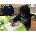 Hafsa painted a portrait of her Mummy.