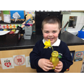 Spencer with his 'gold vase and flower' for Mummy.
