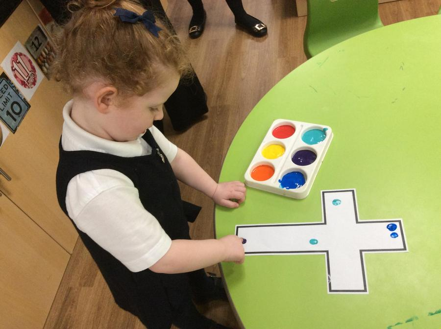 We used our fingerprints to make a large whole class cross.