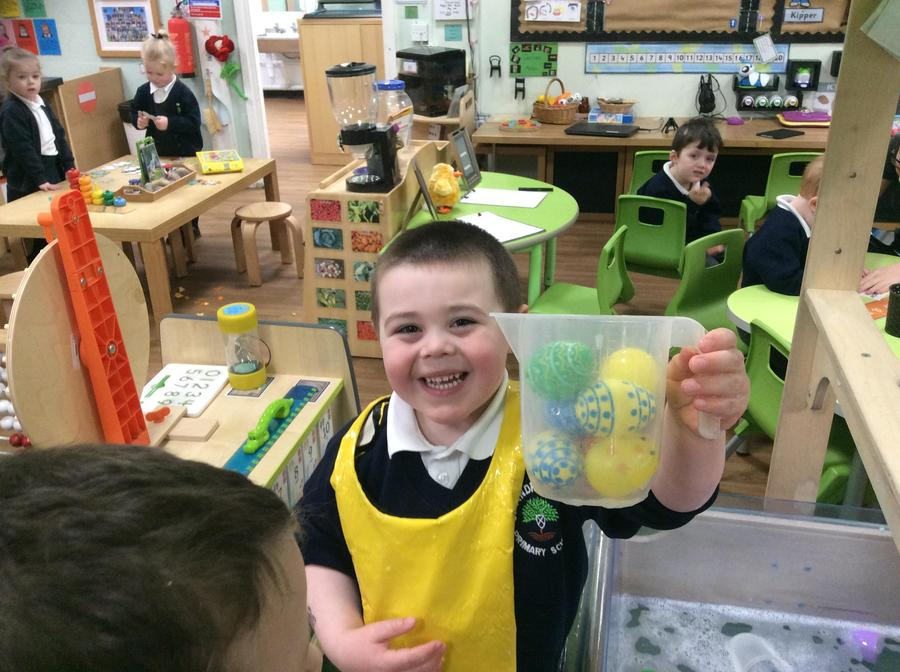 Spencer collecting the eggs from the water.
