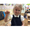 Daisy showing her keyring with her thumbprint.