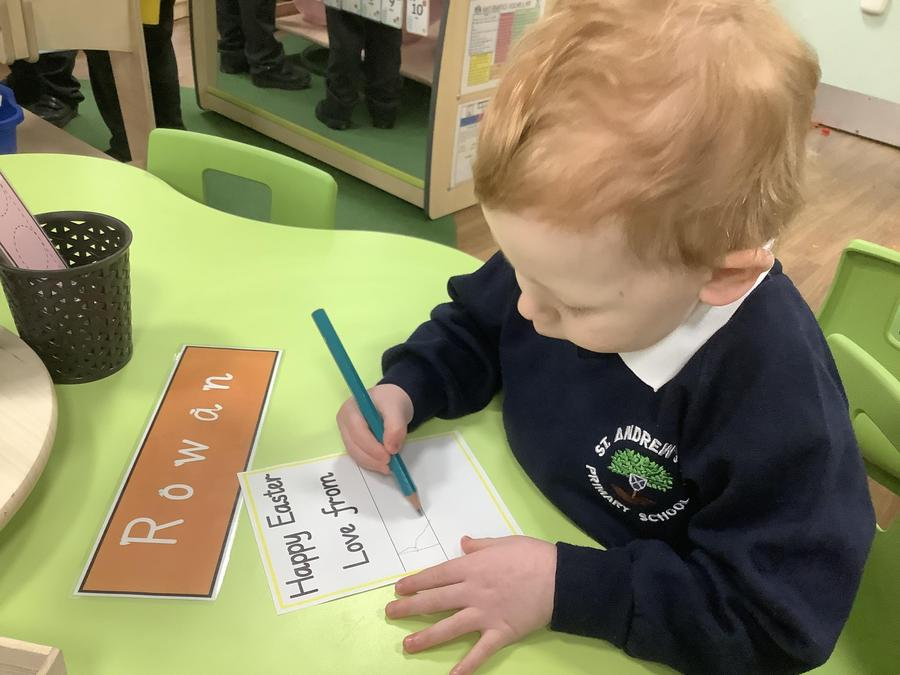 Rowan writing his name ready for his Easter card.
