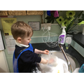 Chase washing up dirty snack cups.