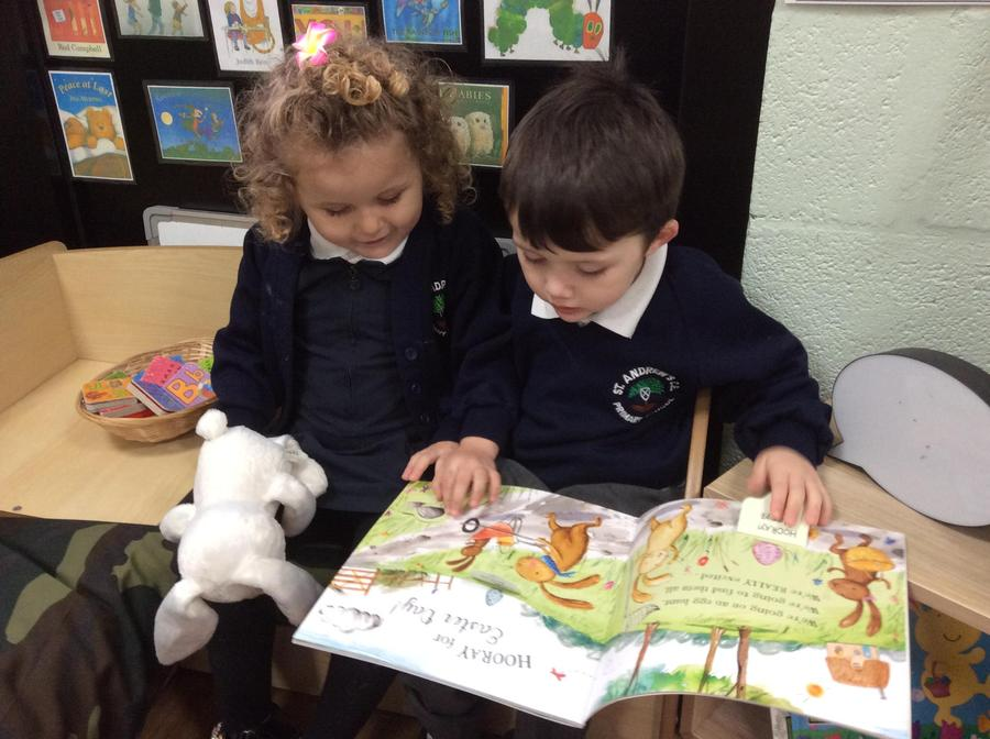 River and Bella enjoying an Easter book.