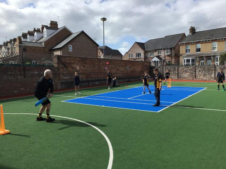Mr. Green challenging Year 6 to a game of cricket