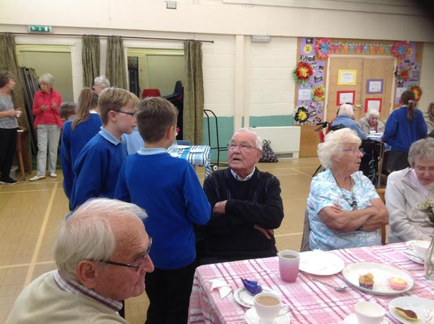 Children get the opportunity to serve the elderly.