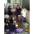 The children are helping to read the story