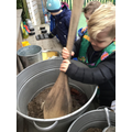 Making mud soup in the mud kitchen