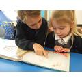KS2 Children reading to KS1 children