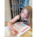 Olivia working hard on her maths