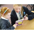 KS2 Children reading to KS1 children