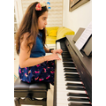 Andia ( Ely Class) playing the piano