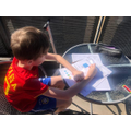 Mason (Salisbury Class) making the most of the sunshine working through his work pack from school