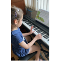 Gabrielle (Coventry Class) having online piano lessons