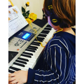 Efe (Lincoln Class) practicing on the keyboard.