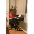 Gabrielle (Lincoln Class) having Piano lessons