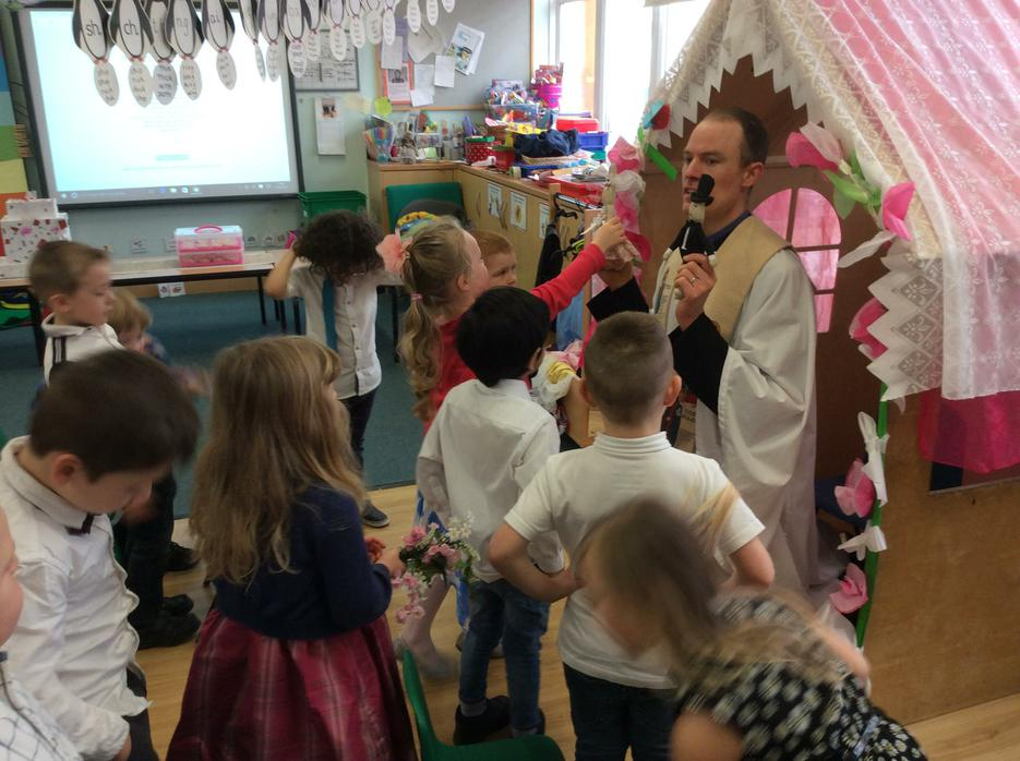 Olly was our vicar, and he's parent from our class