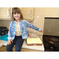 Chef Amber shows off her delicious lasagne.