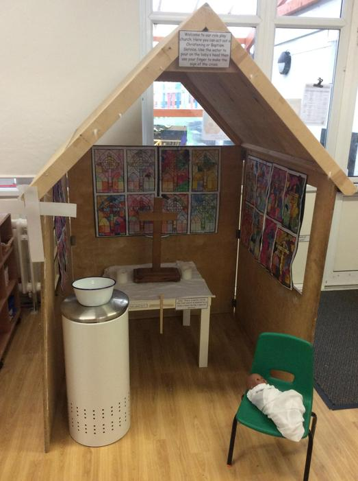 We made a church in our role play area with a font