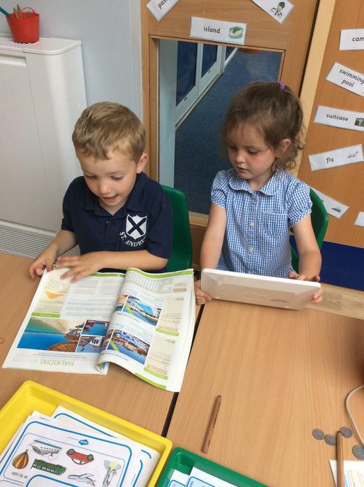 Looking at holiday brochures