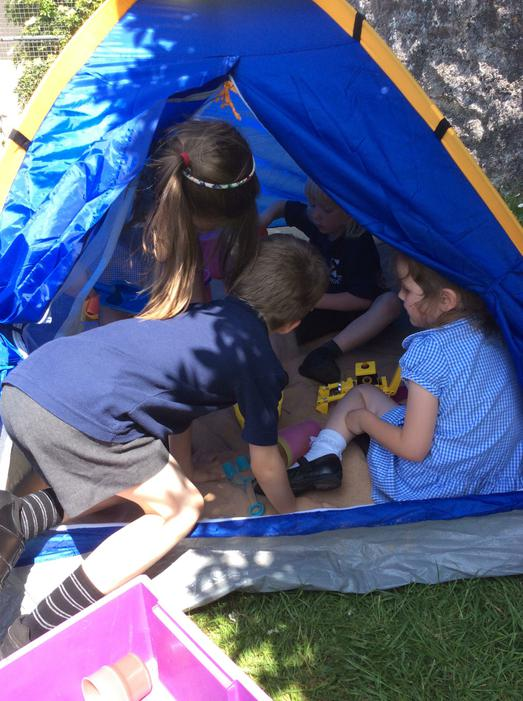 Our new sandpit is inside a tent!